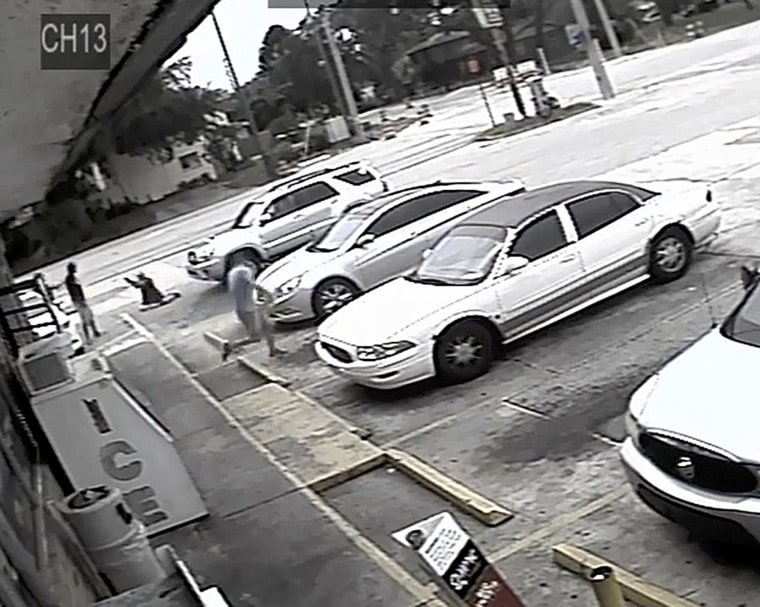 Image: Markeis McGlockton, far left, is shot by Michael Drejka during an altercation in the parking lot of a convenience store in Clearwater
