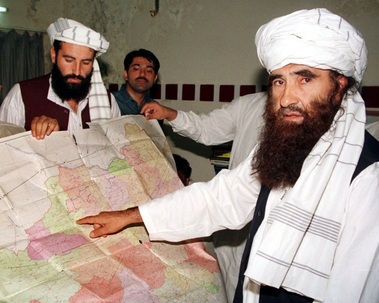 Image: Jalaluddin Haqqani points to a map of Afghanistan in October 2001