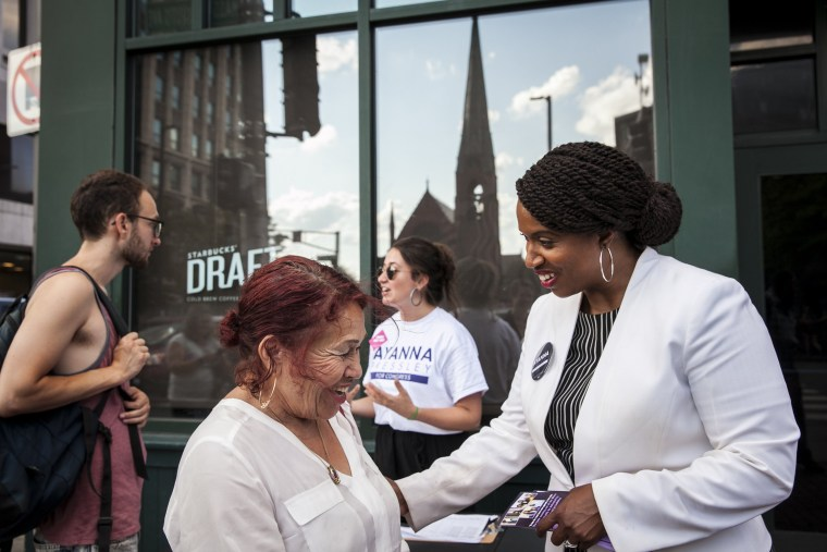 Image: Ayanna Pressley greets people on the streets in Cambridge