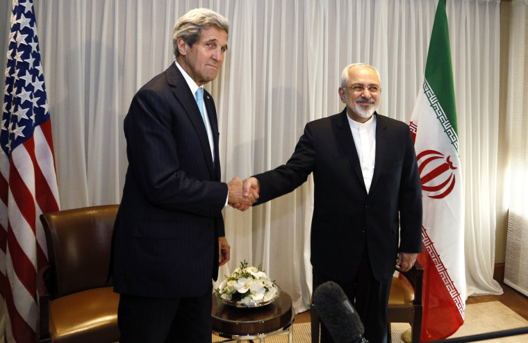 Image: U.S. Secretary of State John Kerry shakes hands with Iranian Foreign Minister Mohammad Javad Zarif before a meeting in Geneva