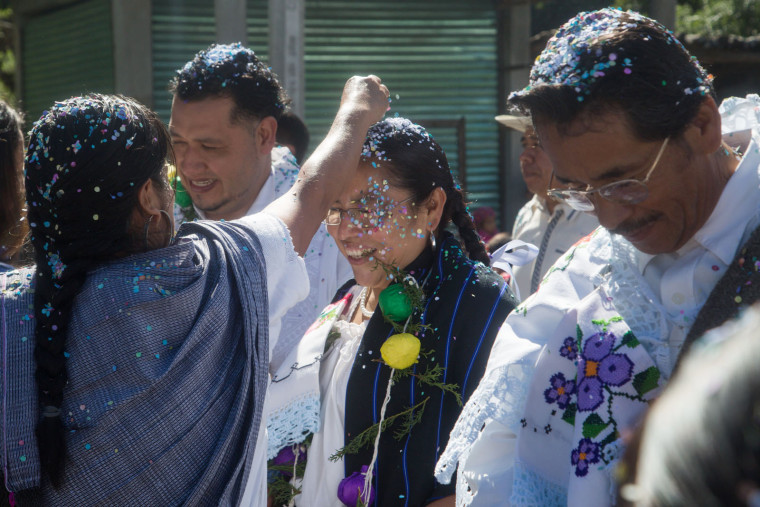 Image: Patricia Hernandez and other newly elected council members march towards the inauguration where they are received with celebratory confetti.