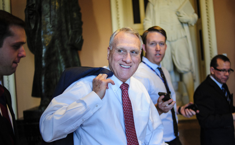 Senate Minority Whip Jon Kyl, a Republican from Arizona, is surrounded by members of the media, as he walks through the U.S. Capitol in Washington on Dec. 30, 2012.