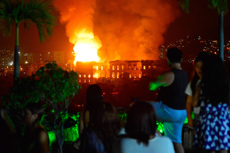 Image: People watch as a massive fire engulfs the National Museum in Rio de Janeiro