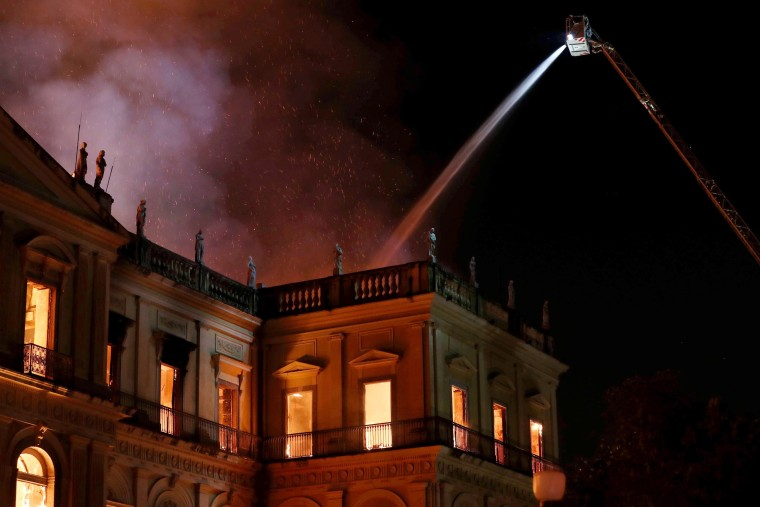 Image: Firefighters work to contain a fire at the National Museum of Rio de Janeiro