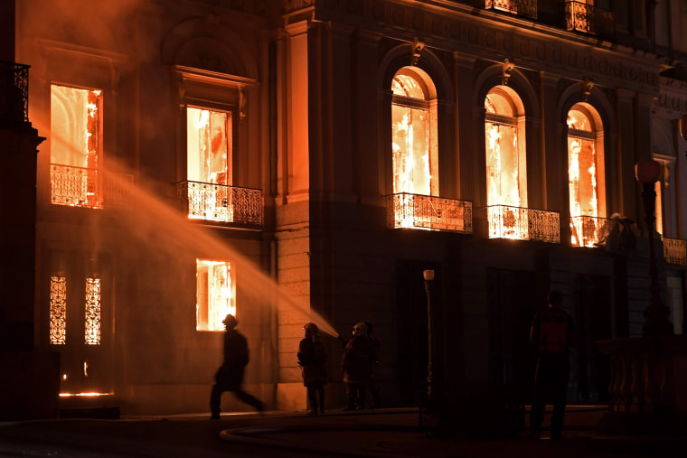 Image: Firefighters work as a massive fire engulfs Brazil's National Museum in Rio de Janeiro