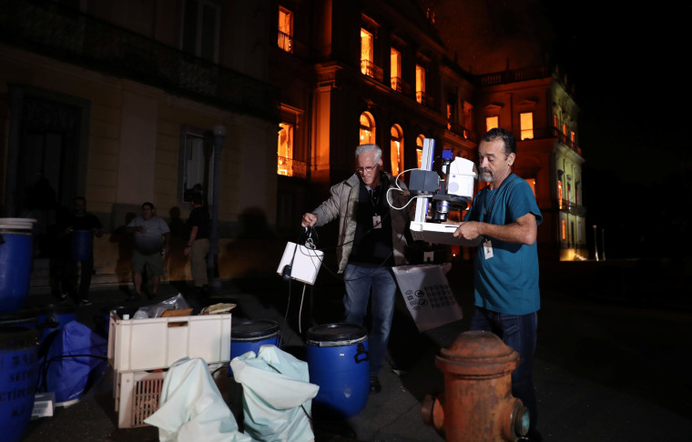 Image: People rescue items during a fire at the National Museum of Brazil in Rio de Janeiro