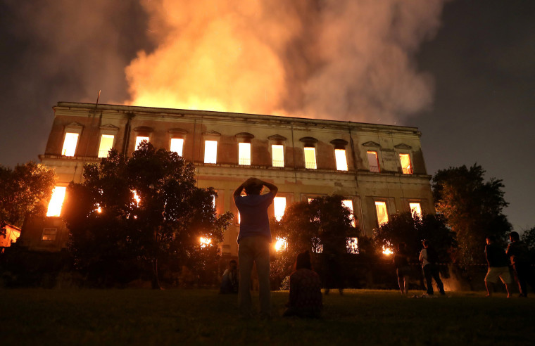 Image: People watch as a fire burns at the National Museum of Brazil in Rio de Janeiro