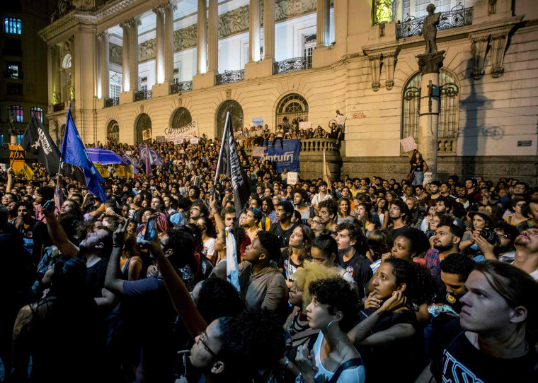 Image: Hundreds of people take part in a protest against the Brazilian government