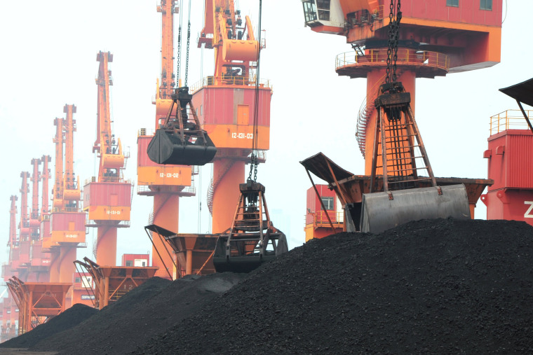 Image: FILE PHOTO: Imported coal is seen lifted by cranes from a coal cargo ship at a port in Lianyungang, Jiangsu