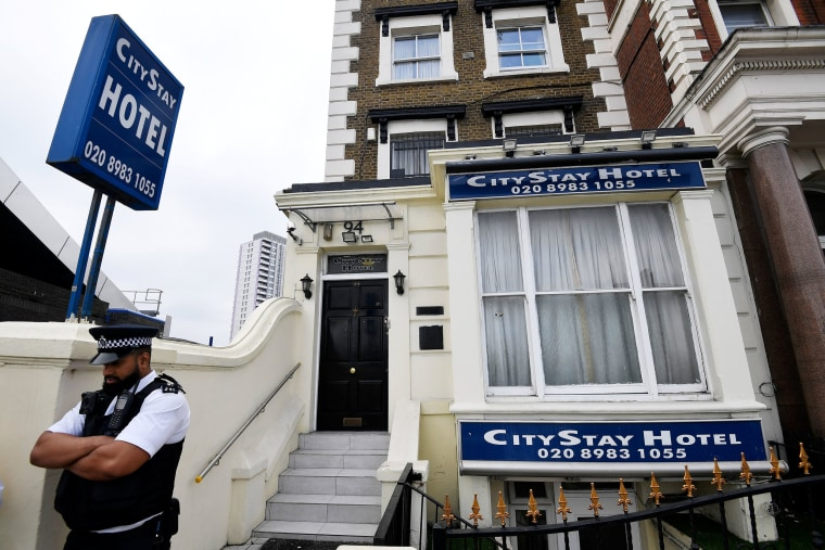 Image: A police officer stands outside the City Stay Hotel used by Alexander Petrov and Ruslan Boshirov
