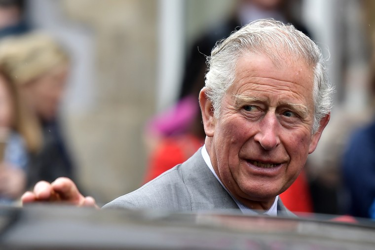 Image: Prince Charles, Prince of Wales waves at Memorial Garden and Strule Arts Centre