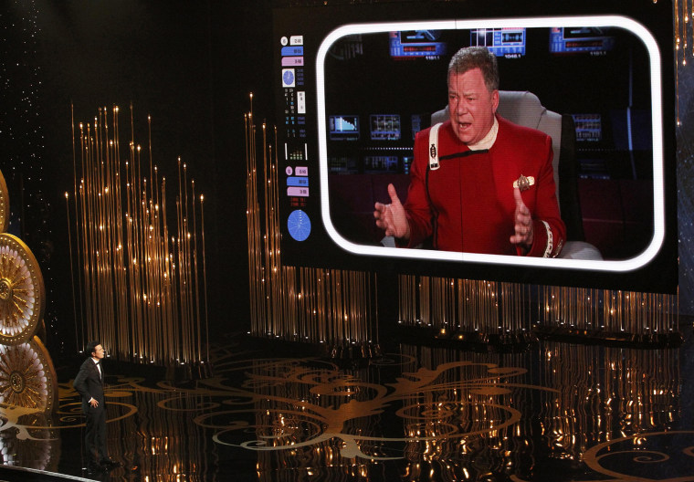 Image: Oscar host Seth MacFarlane watches William Shatner on a screen during the opening segment of the 85th Academy Awards in Hollywood