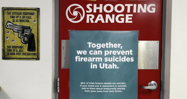 Image: A poster warning of firearm suicide risk on the shooting range door