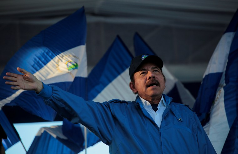 "Image: Nicaraguan President Daniel Ortega waves to supporters during a march called ""We walk for peace and life. Justice"" in Managua"