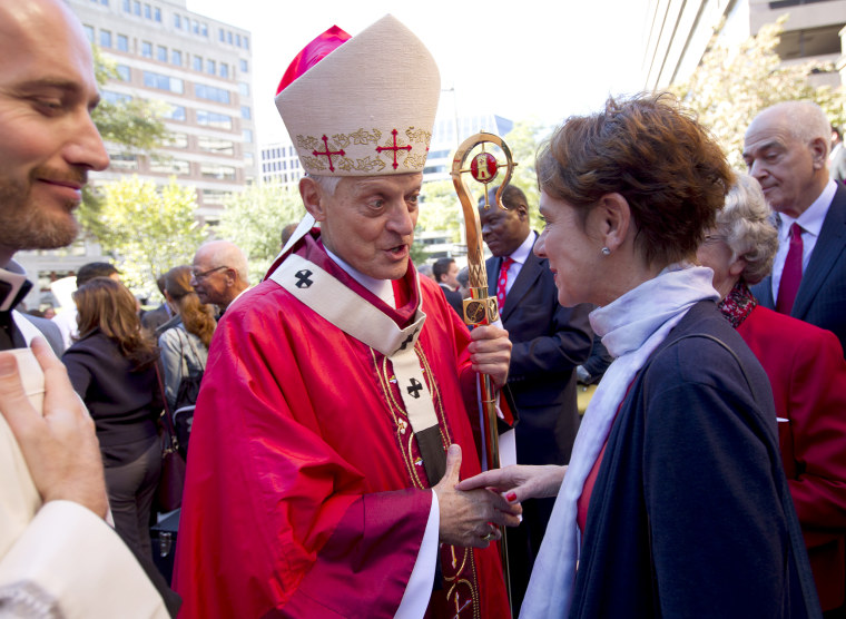 Cardinal Donald Wuerl, Archbishop of Washington shaking hands with churchgoers at St. Mathews Cathedral after the Red Mass in Washington on Oct. 1, 2017.