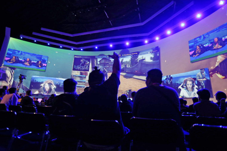 Image: Audience members watch an e-sports tournament during the Game XP 2018 at the Olympic Park in Rio de Janeiro