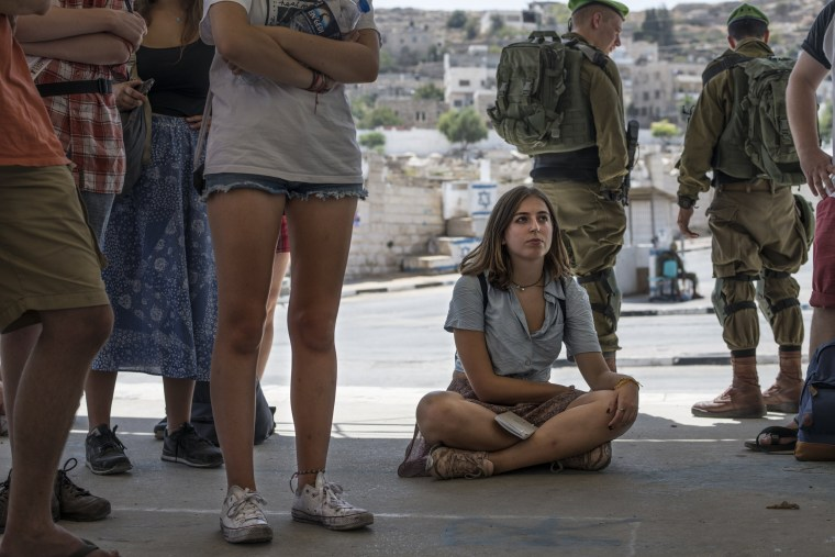 Image: A group of Jewish students from Great Britain visit Hebron on a tour organized by the anti-occupation group Breaking the Silence, which aims to show the reality of everyday life in the occupied city.Tanya Habjouqa / NOOR for NBC News