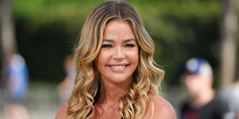 Denise Richards posts about her defense of her wedding (mini) dress