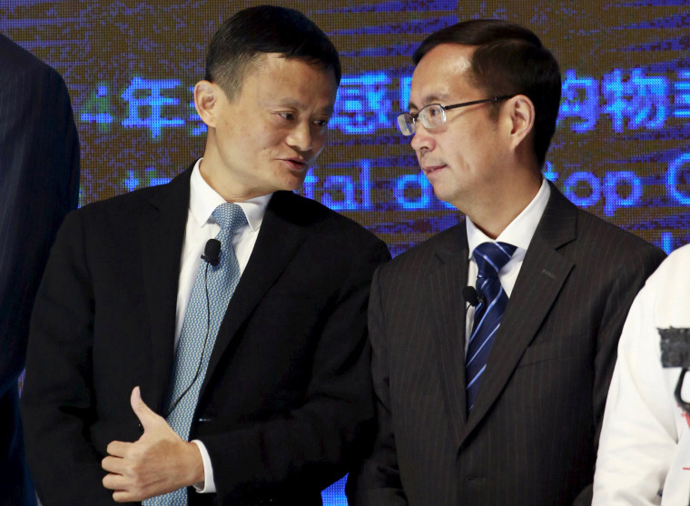Image: FILE PHOTO: Alibaba Founder and Chairman Jack Ma talks to CEO Daniel Zhang at NYSE Bell Ringing ceremony during Alibaba Group's 11.11 Global shopping festival in Beijing