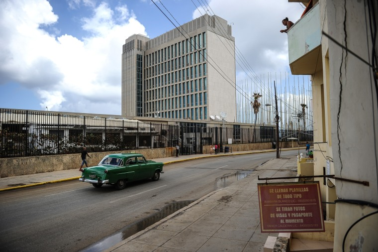 Image: A car passes the U.S. embassy in Havana on Oct. 3, 2017.