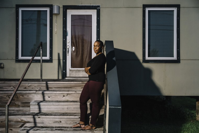 Image: Kamaria Allen stands on the front steps of the home on Reynes Street that she purchased from the Make it Right Foundation