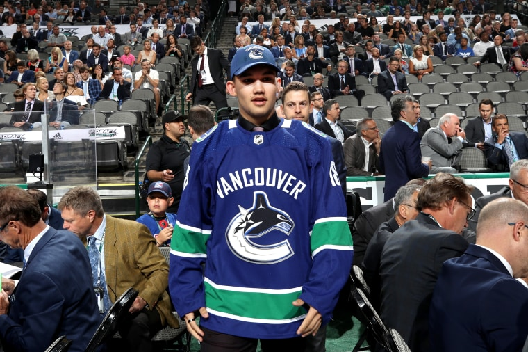 Jett Woo reacts after being selected 37th overall by the Vancouver Canucks during the 2018 NHL Draft