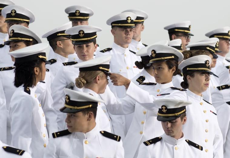 Image: Members of the U.S. Naval Academy Glee Club prepare to perform in Arlington