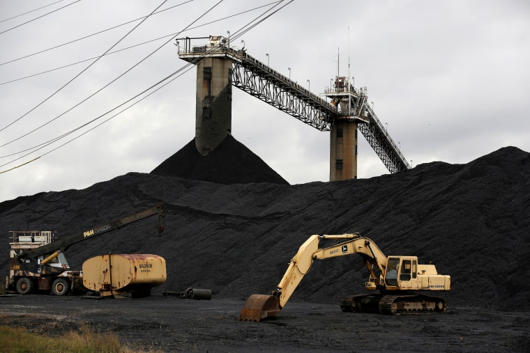 Image: Earth moving equipment sits by a coal pile at the Century Mine in Beallsville, Ohio
