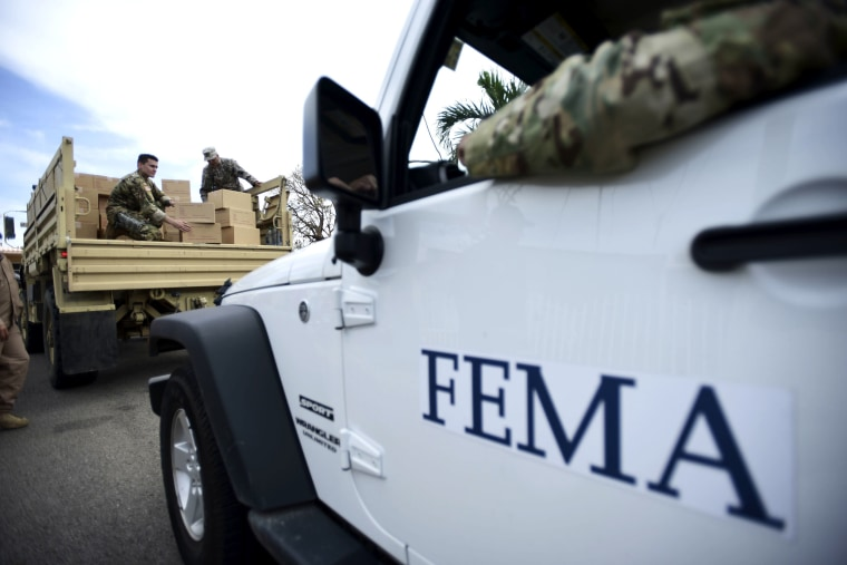 Image: Department of Homeland Security personnel deliver supplies to Santa Ana community residents in the aftermath of Hurricane Maria