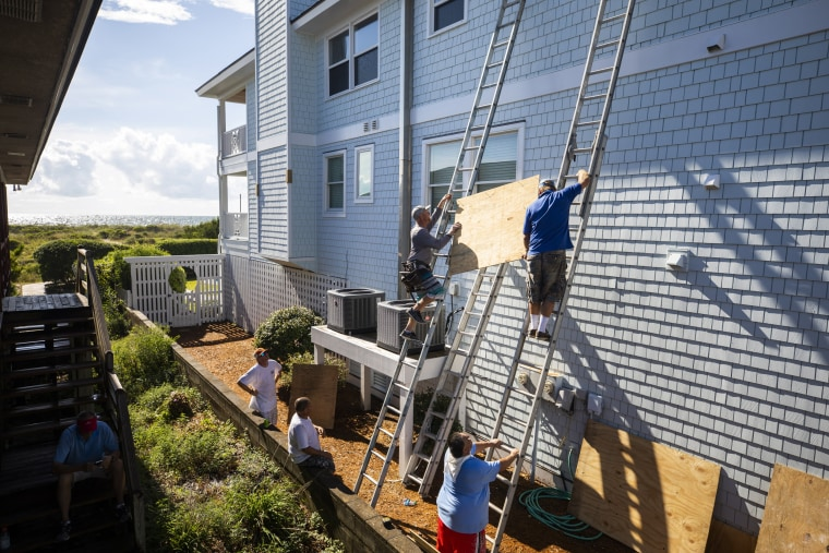 Image: Residents board up a house in Wrightsville, N.C.