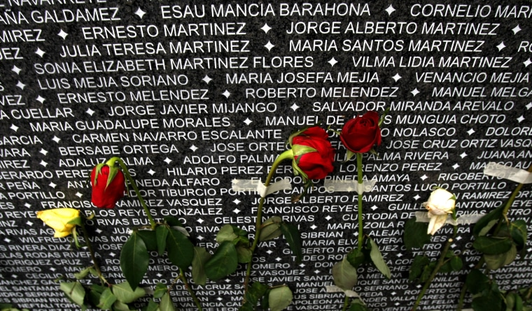 Roses cover a monument carved with the names of people who disappeared during El Salvador's 1980-1992 civil war on the Day of the Dead in San Salvador, on Nov. 2, 2009.