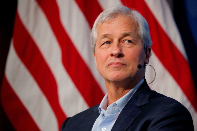 Image: Jamie Dimon, CEO of JPMorgan Chase, takes part in a panel discussion about investing in Detroit at the Kennedy School of Government