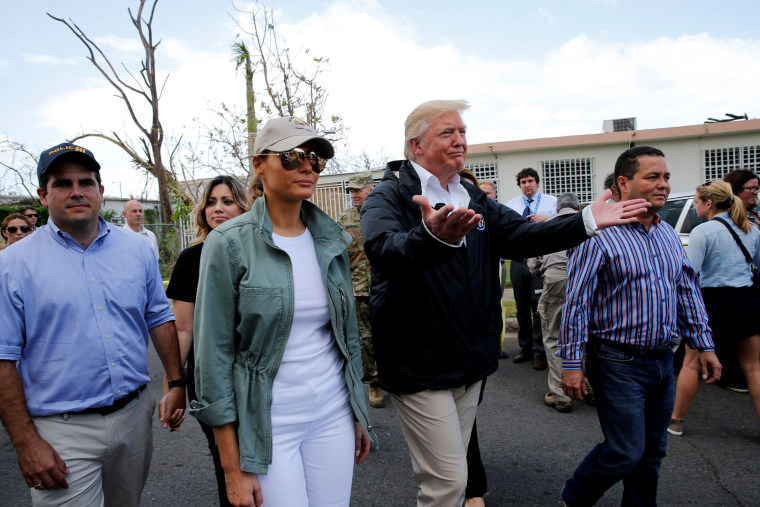 Image: President Trump tours area damaged by Hurricane Maria