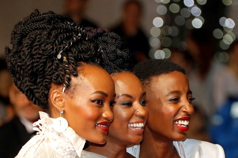 "Image: Director Wanuri Kahiu of ""Rafiki"" poses with actors Sheila Munyiva and Samantha Mugatsia during the 71st Cannes Film Festival in Cannes, France, May 9, 2018."