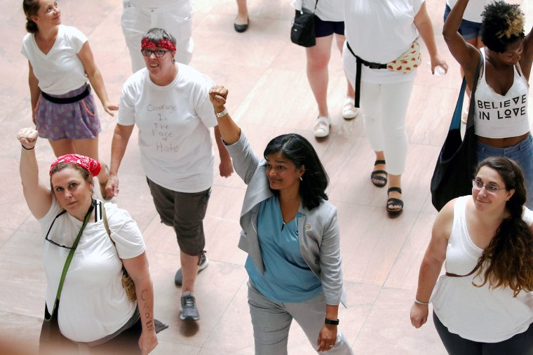 "U.S. Representative Jayapal is arrested with demonstrators calling for ""an end to family detention"" and in opposition to the immigration policies of the Trump administration, at the Hart Senate Office Building on Capitol Hill in Washington"
