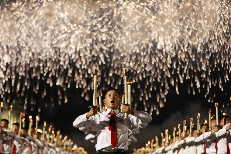 Image: North Korea students torch light parade