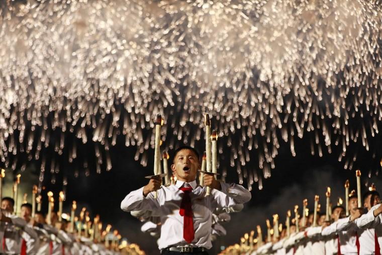 Image: North Korea students torch light parade