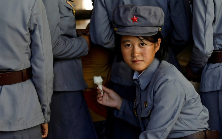 Image: Soldier eats ice cream as she visits a zoo in Pyongyang