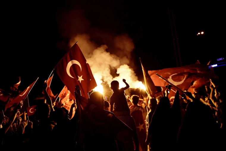 Image: Pro-Erdogan supporters wave Turkish national flags during a rally in Istanbul a few days after the failed coup attempt in July 2016.