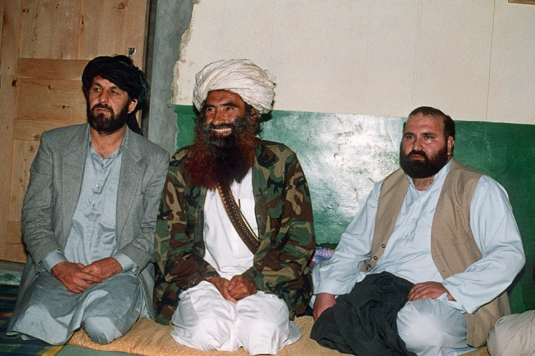 Image: Jalaluddin Haqqani, center, sits with two top commanders