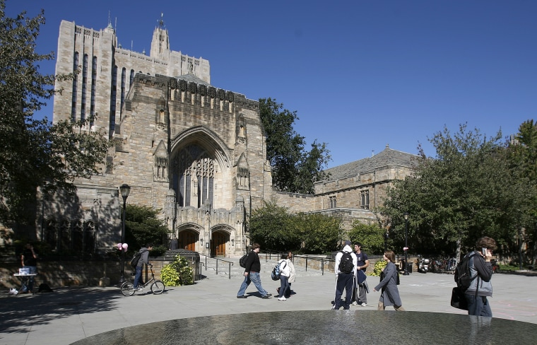 Image: Students walk on the campus of Yale University in New Haven, Connecticut, Oct. 7, 2009.