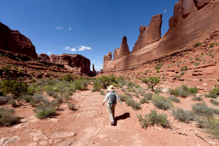 Image: Hikers on the Park Avenue trail in the Arches National Park near Moab, Utah on April 21, 2018.