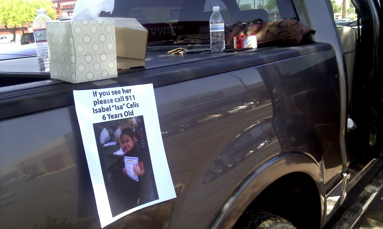 A flyer for missing 6-year-old Isabel Celis is placed on a volunteer's car in Tucson, Arizona on April 22, 2012.