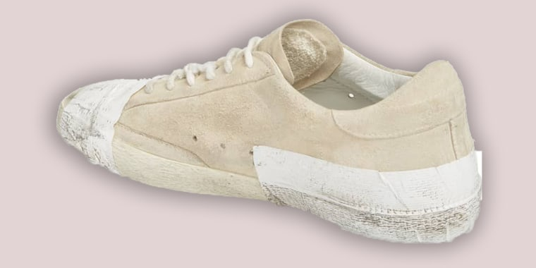 4747ad42a91 Golden Goose taped sneakers accused of glorifying poverty