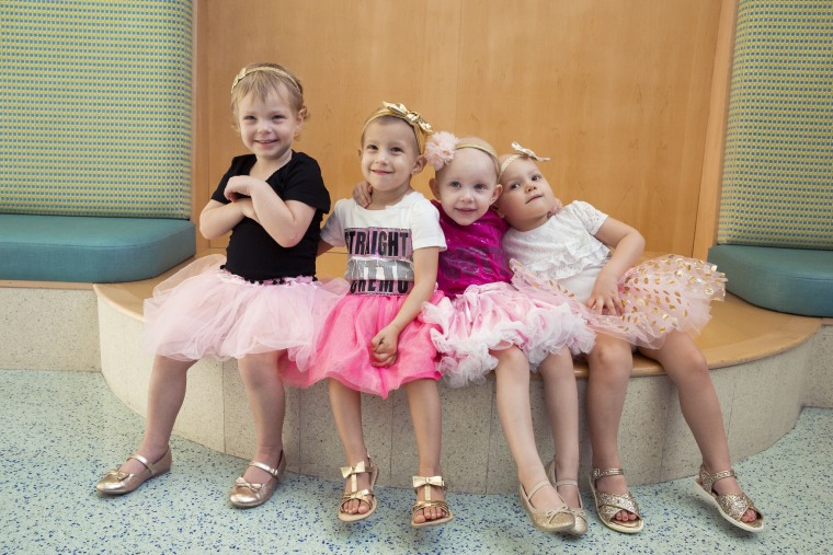 The girls first took this photo in their tutus together in 2016 when they had started treatments for cancer.