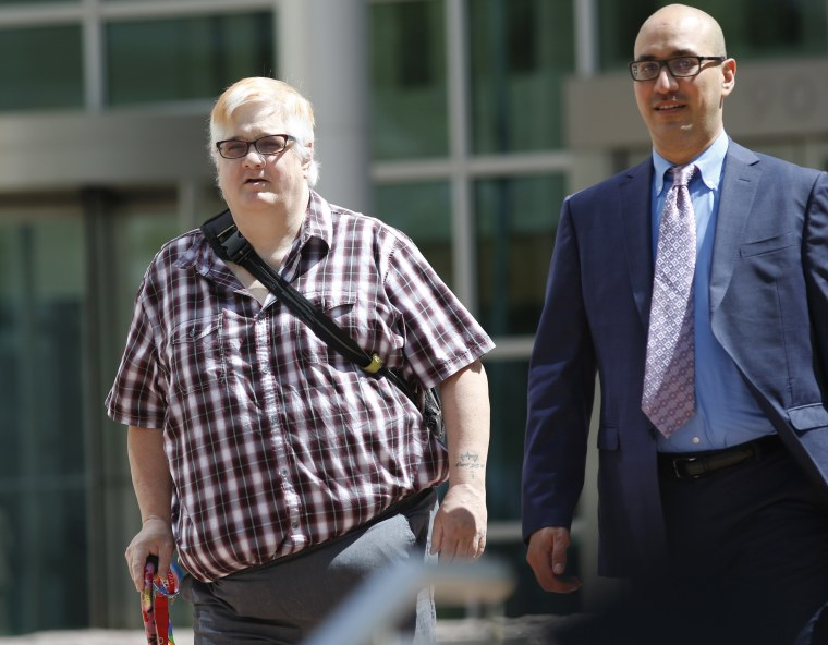Dana Zzyym, of Fort Collins, Colorado, left, and Paul D. Castillo, staff attorney of the South Central regional office of Lambda Legal, leave after a hearing on Zzyym's lawsuit in Denver on July 20, 2016
