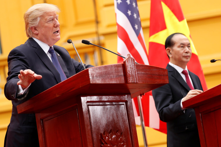 Image: Vietnam's President Tran Dai Quang and U.S. President Donald Trump address a joint news conference at the Presidential Palace in Hanoi