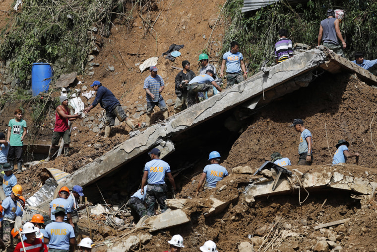 Image: People work during a rescue and retrieval operation for landslide victims caused by Typhoon Mangkhut in Ucab village