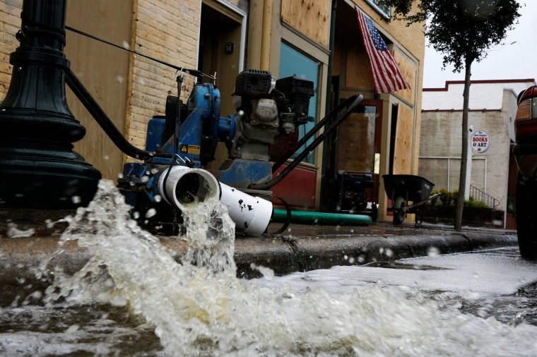 Image: Water is pumped out from store after Hurricane Florence in New Bern, N.C.
