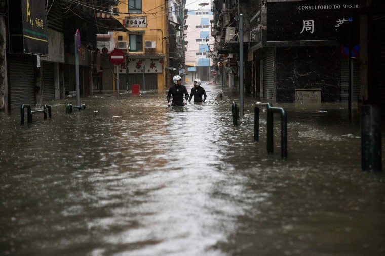 Image: Rescue workers make their way through flood waters after Typhoon Mangkhut hit Macau on Sunday.